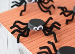 This bottle cap spider Halloween craft not only re-uses plastics in your home, it adds a friendly addition to your Halloween decor.